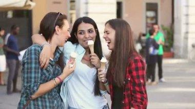 Three happy women eating ice cream — Stock Video