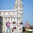 Friends Jumping near Pisa Tower — Stock Photo #74904573