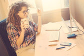 Young woman working at home or in a small office — Stock Photo