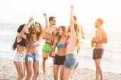 Multiracial group of friends having a party on the beach — Stock Photo
