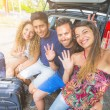 Group of friends taking a selfie before leaving for vacation — Stock Photo #77546216