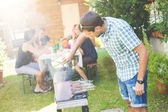 Man cooking meat on the barbecue — Stock Photo