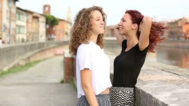 Two girls talking and laughing together outdoor — Stock Video