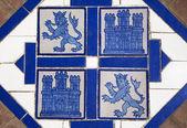 Floor tile with heraldic symbols of Spain — Stock Photo