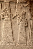 Fragment of babylonian limestone funereal stele — Stock Photo