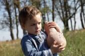 Boy holding pumpkin — Stock Photo