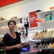 Woman in a shoe store — Stock Photo #59468337