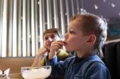 Boy has ice cream with wafer tube — Stock fotografie