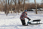 Boy with a snow racer — Foto de Stock