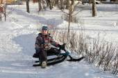 Child on a snow racer — Stock Photo
