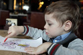 Boy drawing at the cafe — Foto de Stock