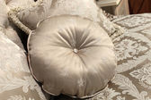 Round cushion on a sofa — Stock Photo