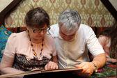 Senior couple with menu — Stock Photo