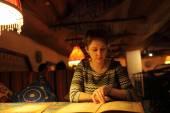 Woman with menu — Stock Photo