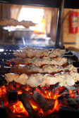 Meat on skewers over the coals — Stock Photo
