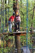 Couple climbing the rope — Stock Photo