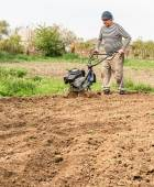 Farmer plowing the field. Cultivating tractor in the field — Stock Photo