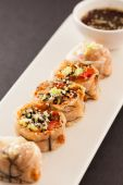 Spring rolls with soy sauce — Stock Photo