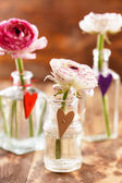 Ranunculus in vases — Stock Photo