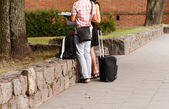Man and woman with bag — Stock Photo