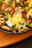 Fried potatoes with meat and egg — Photo