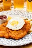 Wiener Schnitzel with egg — Stock Photo