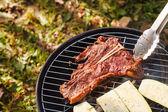 Steak on grill — Stock Photo