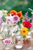 Flowers in bottles — Stock Photo