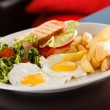 Breakfast with scrambled eggs and fried potatoes — Stock Photo #58982533
