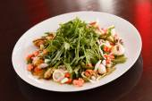 Seafood salad with arugula — Stock Photo
