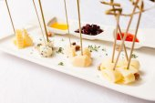 Plate of cheese on white — Stock Photo