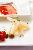 Cheese plate with sauce — Stock Photo