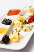 Cheese plate with sauces — Stock Photo