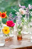Flowers in the bottles still life — Stock Photo