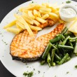 Grilled salmon steak with french fries — Stock Photo #59666121