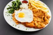 Meat with french fries and egg — Stock Photo