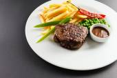 Steak with french fries — Stock Photo