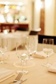 Tables set for meal with glasses — Stock Photo