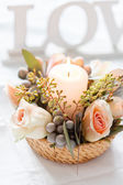 Flower and candle decorations — Stock Photo