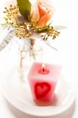 Roses and pink candle — Stock Photo