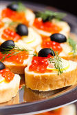 Appetizer with red caviar — Stock Photo