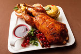 Roasted turkey with apples — Stock Photo