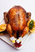 Roasted turkey with oranges and apples — Stock Photo