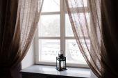 Winter lantern on window — Stockfoto