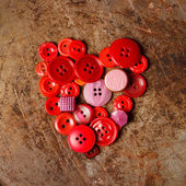 Red sewing buttons heart — Stock fotografie