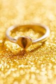 Golden ring with heart — Stock Photo