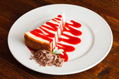 Cheesecake with strawberry sauce — Stock Photo