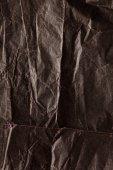 Black wrinkled  paper — Stock Photo