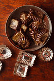 Chocolate sweets with powder — Stock Photo