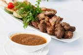 Meat appetizer with sauce — Stock Photo